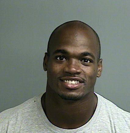 This photo provided by the Montgomery County sheriffs office shows the booking photo of Adrian Peterson.   Peterson will be in a Texas courtroom Wednesday, OIct. 8, 2014,  for the first time since ...