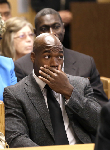 Minnesota Vikings running back Adrian Peterson waits inside a courtroom while making his first court appearance Wednesday, Oct. 8, 2014, in Conroe, Texas. Judge Kelly Case tentatively set a Dec. 1 ...