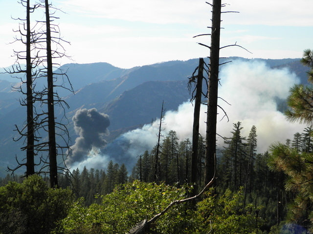 Smoke rises from a plane crash Tuesday, Oct. 7, 2014, near Chinquapin, California. The S-2T air tanker fighting a wildfire near Yosemite National Park in Northern California crashed, killing the p ...