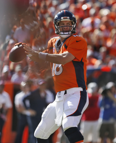 Denver Broncos quarterback Peyton Manning (18) throws his 500th career touchdown pass during the first half of an NFL football game against the Arizona Cardinals, Sunday, Oct. 5, 2014, in Denver.  ...