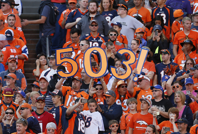 """In this Oct. 5, 2014, file photo, Denver Broncos fans hold signs reading """"503"""", the amount of career touchdown passes tDenver Broncos quarterback Peyton Manning has, during an NFL football game ag ..."""
