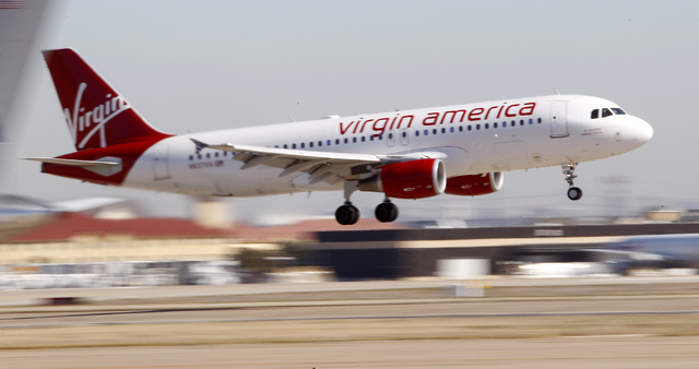 In this Dec. 1, 2010 file photo, Virgin America's inaugural flight between Los Angeles an Dallas Fort Worth International Airport comes in for a landing in Grapevine, Texas. Passengers cherish Vir ...