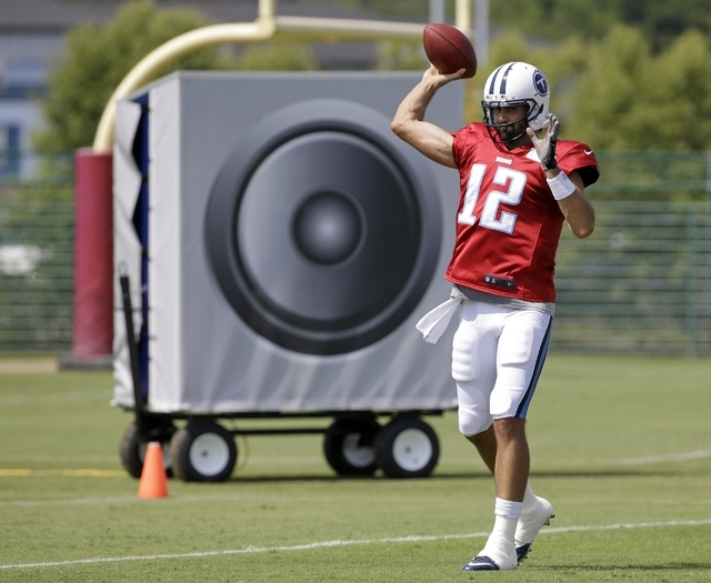 In this July 31, 2014 file photo, Tennessee Titans quarterback Charlie Whitehurst warms up in front of a large speaker during NFL football training camp in Nashville, Tenn. Teams use speakers deli ...