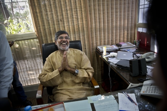 Indian children's rights activist Kailash Satyarthi laughs as he addresses the media at his office in New Delhi, India, Friday, Oct. 10, 2014. Malala Yousafzai of Pakistan and Satyarthi of India j ...