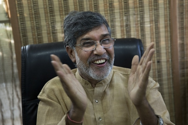 Indian children's rights activist Kailash Satyarthi gestures as he addresses the media at his office in New Delhi, India, Friday, Oct. 10, 2014. Malala Yousafzai of Pakistan and Satyarthi of India ...