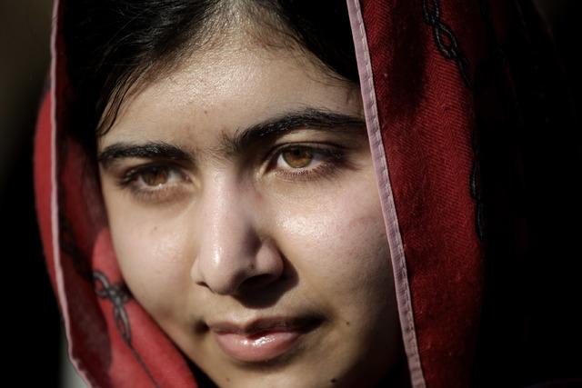Malala Yousafzai visits Zaatari refugee camp near the Syrian border in Mafraq, Jordan, Feb. 18, 2014 . Children's rights activists Yousafzai, 17, of Pakistan and Kailash Satyarthi of India were aw ...
