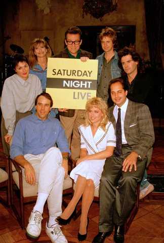 "FILE - In this Dec. 9, 1986 file photo, the cast of NBC's ""Saturday Night Live,"" clockwise, from left, Nora Dunn, Jan Hooks, Phil Hartman, Dana Carvey, Dennis Miller, Jon Lovitz, Victori ..."
