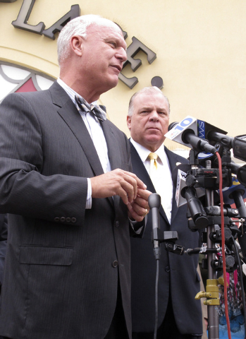 Atlantic City Mayor Don Guardian, left, speaks as New Jersey Senate President Steven Sweeney, right looks on during news conference on the boardwalk in Atlantic City, N.J., Friday Oct. 10, 2014. S ...