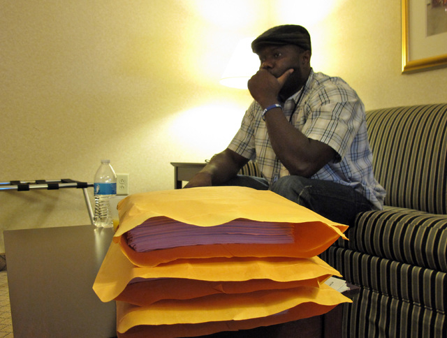 Josephus Weeks, nephew of ebola patient Thomas Eric Duncan who died earlier this week in Dallas, sits behind a stack of medical documents in a hotel room, Friday, Oct. 10, 2014, in Kannapolis, Nor ...
