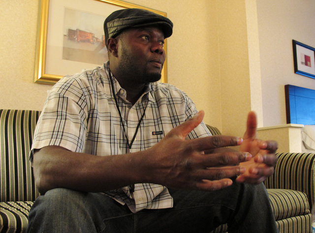 Josephus Weeks, nephew of Ebola patient Thomas Eric Duncan who died earlier this week in Dallas, speaks with a reporter in a hotel room, Friday, Oct. 10, 2014, in Kannapolis, North Carolina. Dunca ...