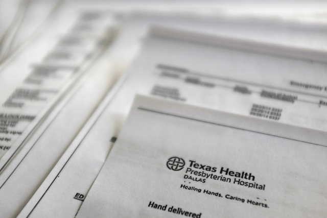 A copy of Thomas Eric Duncan's medical records from Texas Health Presbyterian Hospital is shown Friday, Oct. 10, 2014, provided by Duncan's family to The Associated Press. The records encompass hi ...