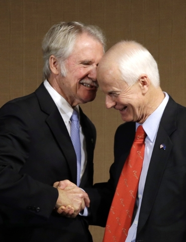 Oregon Democratic Gov. John Kitzhaber, left, shakes hands with Republican challenger Dennis Richardson after their gubernatorial debate in Portland, Ore., Friday, Oct. 10, 2014.(AP Photo/Don Ryan)