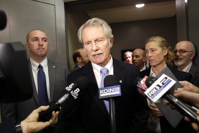 Oregon Democratic Gov. John Kitzhaber makes a statement before his gubernatorial debate with Republican challenger Dennis Richardson in Portland, Ore., Friday, Oct. 10, 2014. (AP Photo/Don Ryan)