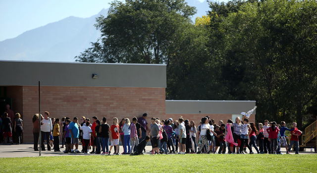 In this Sept. 11, 2014 file photo, students line up to go back inside after recess at Westbrook Elementary School in Taylorsville, Utah. (AP Photo/The Deseret News, Kristin Murphy, File)