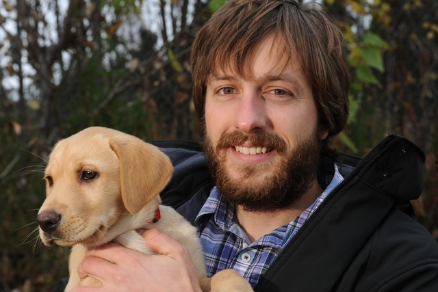 Justin Priest holds his 9-week-old yellow lab Lily in Anchorage on Thursday, Oct. 9, 2014. (AP Photo/The Alaska Dispatch News, Bill Roth)