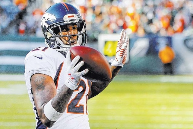 Denver Broncos cornerback Aqib Talib skips into the end zone as he returns an interception for a touchdown against the New York Jets during the fourth quarter of an NFL football game, Sunday, Oct. ...