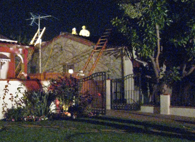 This November, 2007 photo provided by Jim Caccavo shows firefighters on the roof of the fire-damaged home of his then-neighbor, Sarah Cheiker, in Los Angeles. The elderly Los Angeles woman whose n ...