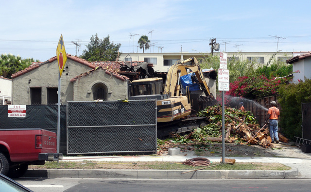 This August, 2008 photo provided by Jim Caccavo shows the demolition of the former home of his neighbor Sarah Cheiker in Los Angeles. The elderly Los Angeles woman whose neighbors believed had die ...