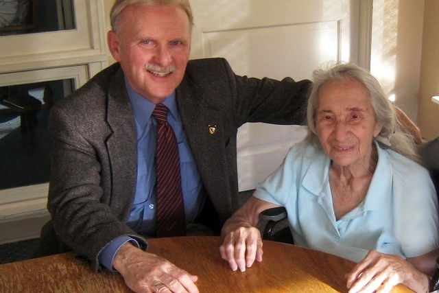 This November, 2012 photo provided by Jim Caccavo, left, shows him with his former neighbor Sarah Cheiker, then aged 89, in Freyberg, Maine. (AP Photo/Courtesy Jim Caccavo)