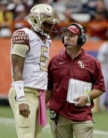 Florida State head coach Jimbo Fisher, right, talks to quarterback Jameis Winston (5) during the second half of an NCAA college football game against Syracuse, Saturday, Oct. 11, 2014, in Syracuse ...
