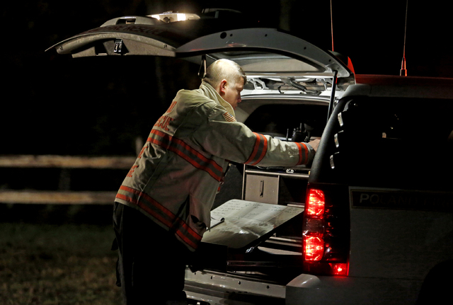 Mark Bosse, chief of the Poland, Maine, Fire Department, works at Harvest Hill Farms, the site of a hayride accident that injured multiple people Saturday, Oct. 11, 2014.  Police in Maine confirm  ...