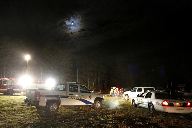 Emergency personnel work at the site of a hayride rollover that injured multiple people Harvest Hill Farms in Mechanic Falls, Maine, Saturday, Oct. 11, 2014. Police in Maine confirm a teen has die ...