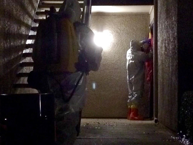 In this photo released via Twitter by the City of Dallas Public Information Managing Director Sana Syed, members of Dallas Fire-Rescue Haz Mat Unit tape off a door at the The Village Bend East apa ...