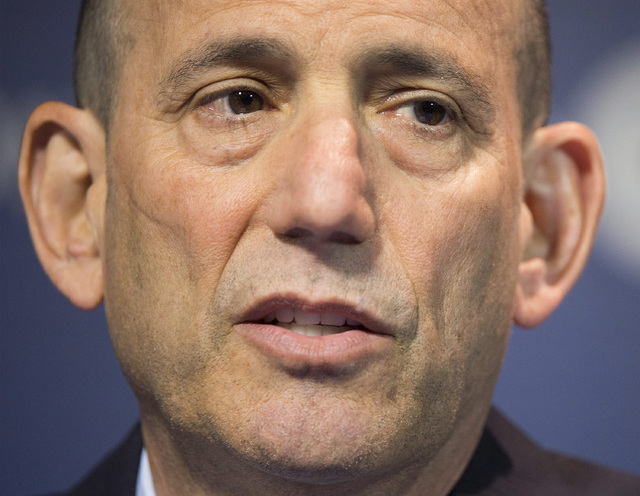 In this June 11, 2014, file photo, MLS Commissioner Don Garber speaks to reporters prior to an MLS soccer game between the Montreal Impact and DC United in Montreal. Garber has criticized U.S. coa ...