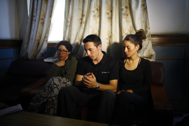 From left to right, Israeli trekkers Linor Kajan, Yakov Megreli and Maya Ora attend the media at the Army hospital in Katmandu, Nepal, Thursday, Oct. 16, 2014. Nepal army rescuers in helicopters s ...