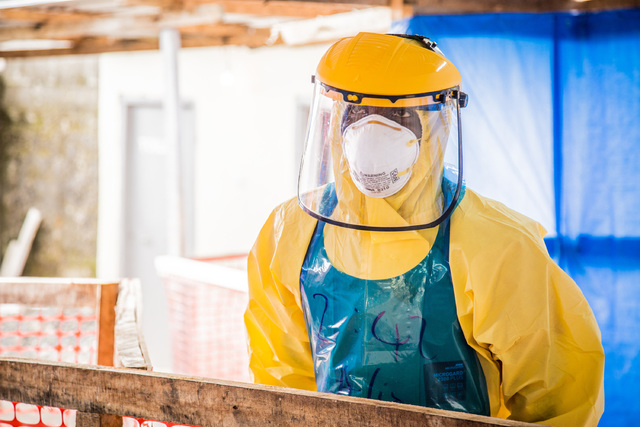 A healthcare worker in protective gear is seen at an Ebola treatment center in the west of Freetown, Sierra Leone, Thursday, Oct. 16, 2014. (AP Photo/Michael Duff)