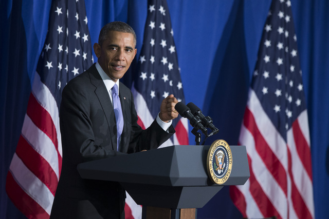 President Barack Obama delivers remarks at the Consumer Financial Protection Bureau, on Friday, Oct. 17, 2014, in Washington. Obama signed an executive order to improve security measures for gover ...