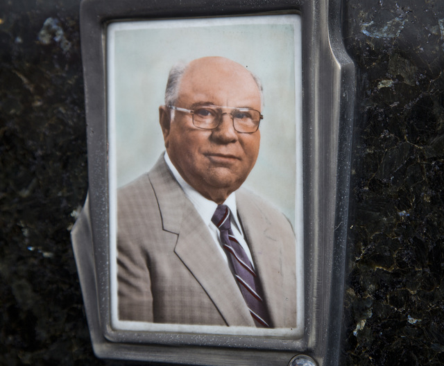 This July 28, 2014, photo shows Jakob Denzinger's portrait on the tombstone of his empty grave in Cepin eastern Croatia. Denzinger is among dozens of death camp guards and suspected Nazi war crimi ...