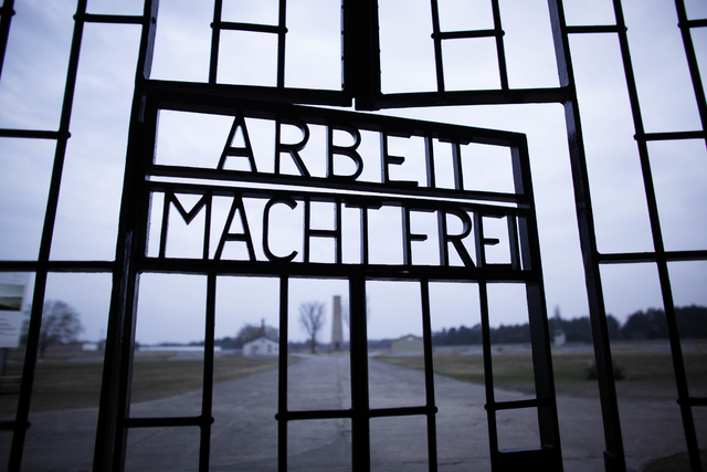 This Jan. 27, 2012, file photo shows the words 'Arbeit Macht Frei' (Work Sets You Free) at the main entrance of the Sachsenhausen Nazi concentration camp on the international Holocaust remembrance ...