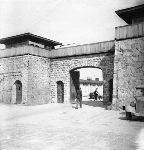 This July 1945 file photo shows the main gate at Mauthausen concentration camp, near Linz, Austria. An Associated Press investigation found dozens of suspected Nazi war criminals and SS guards col ...
