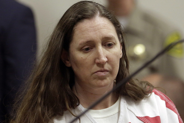 Megan Huntsman, accused of killing six of her newborn babies and storing their bodies in her garage, appears in court Monday, Oct. 20, 2014, in Provo, Utah. Huntsman made a brief court appearance  ...
