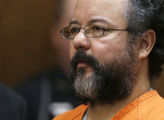 In this Aug. 1, 2013, file photo, Ariel Castro sits in the courtroom during his sentencing phase in Cleveland. Michelle Knight, one of the three women held captive in a Cleveland home for about a  ...