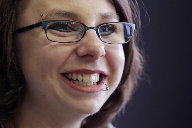 In this Thursday, June 26, 2014, file photo, Michelle Knight smiles during an interview in Cleveland. During an interview on Sunday, Oct. 19, 2014, Knight, one of the three women held captive in a ...