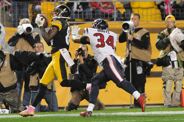 Pittsburgh Steelers wide receiver Antonio Brown (84) tries  to make a catch past Houston Texans cornerback A.J. Bouye (34) in the fourth quarter of the NFL football game against the Pittsburgh Ste ...