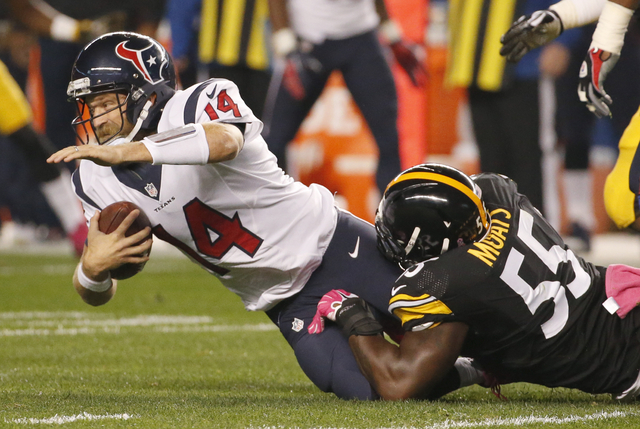 Houston Texans quarterback Ryan Fitzpatrick (14) is tackled by Pittsburgh Steelers outside linebacker Arthur Moats (55)in the first half of the NFL football game, Monday, Oct. 20, 2014 in Pittsbur ...