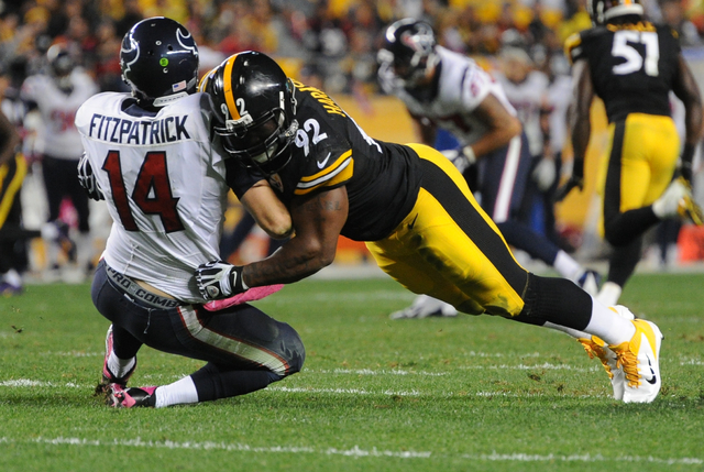 Pittsburgh Steelers linebacker James Harrison (92) hits Houston Texans quarterback Ryan Fitzpatrick (14) in the third quarter of the NFL football game, Monday, Oct. 20, 2014 in Pittsburgh. (AP Pho ...