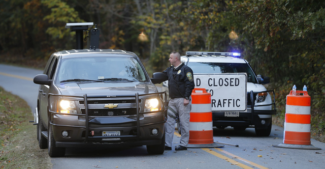 Police block the road leading to the scene of a death investigation in connection with the disappearance of University of Virginia student Hanna Graham in Albermarle County, Va., Saturday, Oct. 18 ...