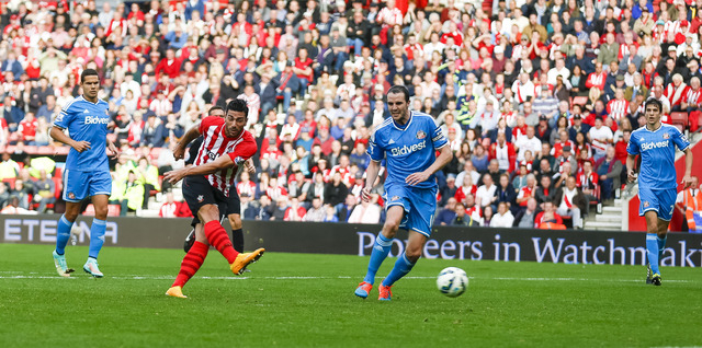 Southampton's Graziano Pelle scores his second goal during their English Premier League soccer match against Sunderland at St. Mary's Stadium, Southampton, England, Saturday, Oct. 18, 2014. (AP Ph ...