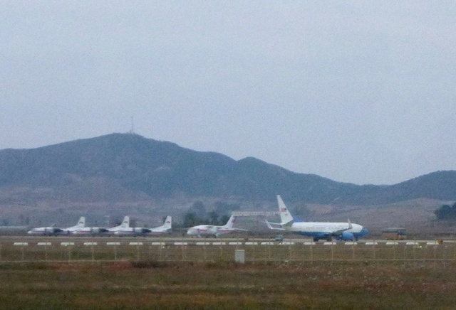 What appears to be a U.S. Air Force passenger jet, right, is parked on the tarmac of Sunan International Airport in Pyongyang, North Korea, Tuesday, Oct. 21, 2014. The State Department says Jeffre ...