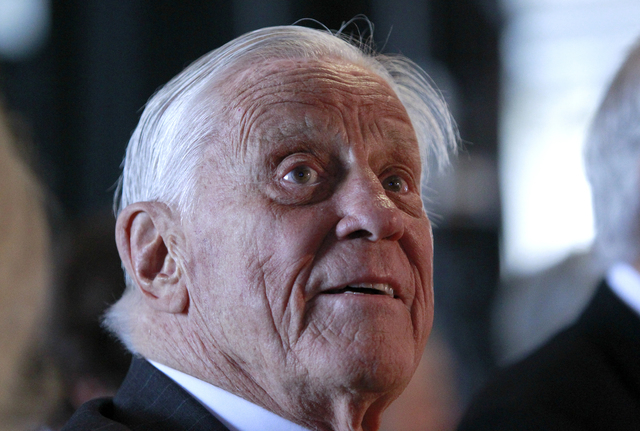 FILE - In this June 11, 2012 file photo, Ben Bradlee, former executive editor of The Washington Post, listens during an event sponsored by The Washington Post to commemorate the 40th anniversary o ...