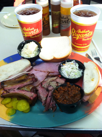 A plate of food at Arthur Bryant's, the legendary barbecue restaurant in Kansas City, Mo. The plate includes ham, brisket, ribs, potato salad, coleslaw, beans and a turkey sandwich. Bryant's is co ...
