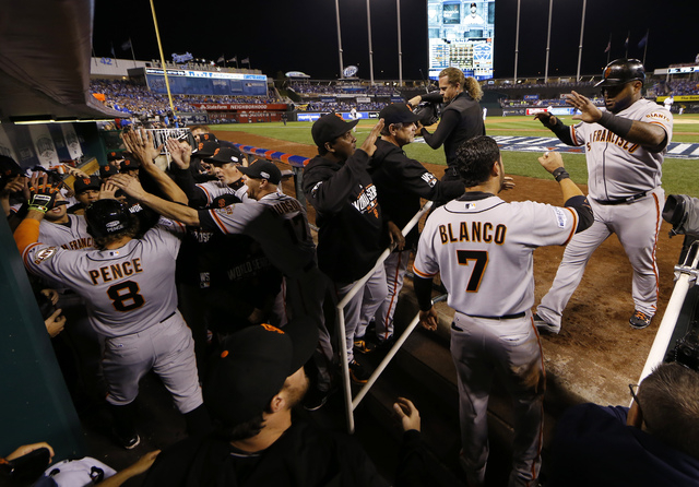 San Francisco Giants Hunter Pence (8) is congratulated by his teammates after hitting a two-run home run during the first inning of Game 1 of baseball's World Series Tuesday, Oct. 21, 2014, in Kan ...