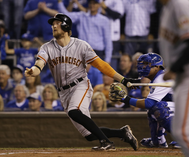 San Francisco Giants right fielder Hunter Pence watches his two-run home run during the first inning of Game 1 of baseball's World Series Tuesday, Oct. 21, 2014, in Kansas City, Mo. (AP Photo/Char ...
