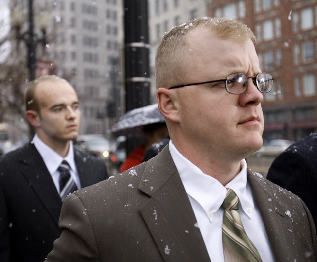In this Dec. 8, 2008 file photo, former Blackwater Worldwide security guards, Paul Slough, right and Nick Slatten leave federal court in Salt Lake City. A jury returned guilty verdicts for Slough, ...