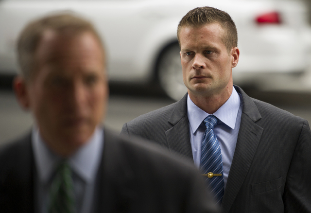 In this June 11, 2014 file photo, former Blackwater Worldwide guard Evan Liberty, right, arrives at federal court in Washington. A jury returned guilty verdicts for Liberty and three other former  ...