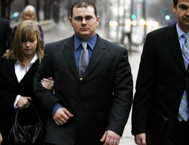 In this Jan. 6, 2009 file photo, former Blackwater Worldwide security guard Dustin Heard leaves federal court in Washington. A jury returned guilty verdicts for Heard and three other former Blackw ...